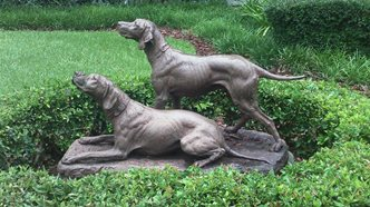 modern photo of statue of 2 hunting dogs.