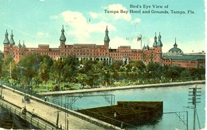 Historic postcard showing the Tampa Bay Hotel. River in foreground.
