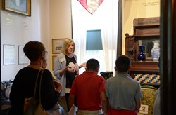 Museum docent sharing history with students