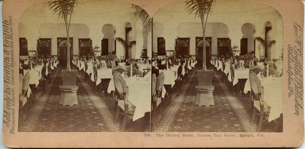 stereocard of empty dining room at TBH tables and chairs set for dinner