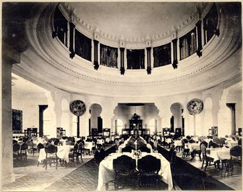 Wide view of the Dining Room at the Tampa Bay Hotel.  The room is full of tables and chairs.