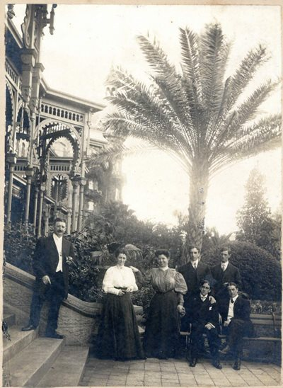 gentleman and ladies posed on the steps of the Tampa Bay Hotel