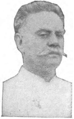 portrait of man with mustache wearing chef jacket